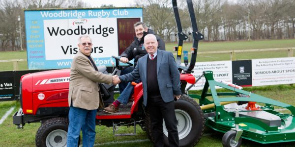 Andy-Rayner-R-TNS-Groundcare-Sales-Manager-hands-over-tractor-to-Bob-Double-L-WRUFC-Projects-Manager-Garry-Sykes-on-tractor-WRUFC-Head-Groundsman